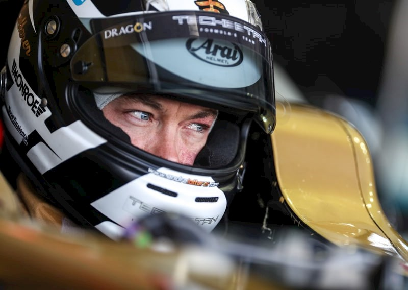 close up of racing driver Andre Lotterer wearing his helmet
