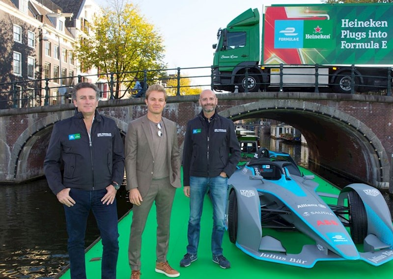 Formula E Chair Alejandro Agag poses with Heineken executives on a canal boat